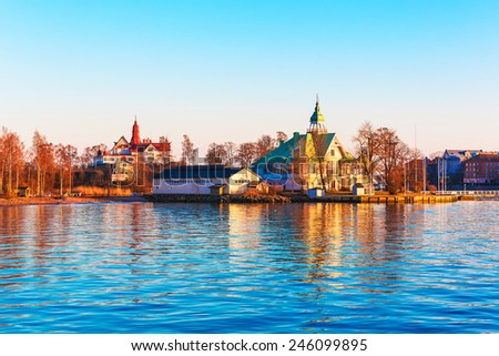 Scenic spring evening sea sunset in the harbor of the Old Town of Helsinki, Finland - stock photo