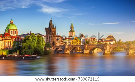 Scenic spring sunset aerial view of the Old Town pier architecture and Charles Bridge over Vltava river in Prague, Czech Republic