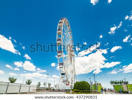 Scenic spring view of  the Ferris wheel over the canal port, in Rimini, Italy
