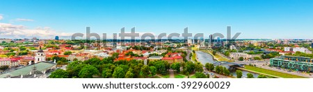 Scenic summer aerial panorama of modern business financial district architecture buildings and Old Town in Vilnius, Lithuania - stock photo
