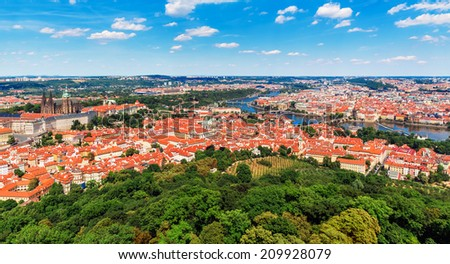 Scenic summer aerial panorama of the Old Town architecture in Prague, Czech Republic with Saint Vitus Cathedral, Vltava River and Charles Bridge - stock photo