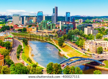 Scenic summer aerial view of modern business financial district architecture buildings and Old Town in Vilnius, Lithuania - stock photo