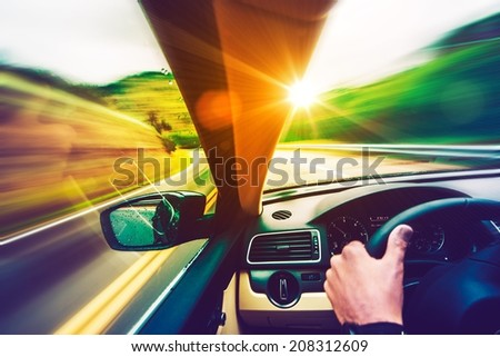Scenic Summer Drive. Mountain Road and Sunset Scenery From the Speeding Car. Scenic Road - stock photo