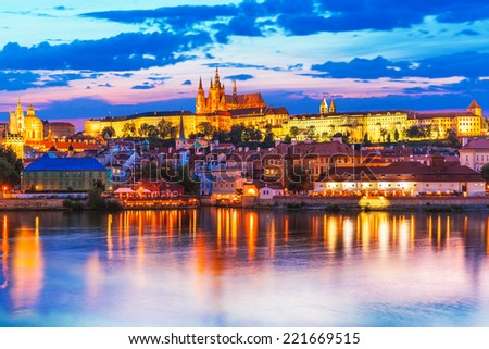 Scenic summer evening panorama of the Old Town architecture with Vltava river and St.Vitus Cathedral in Prague, Czech Republic - stock photo