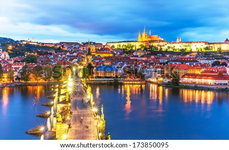 Scenic summer evening panorama of the Old Town architecture with Vltava river, Charles Bridge and St.Vitus Cathedral in Prague, Czech Republic - stock photo