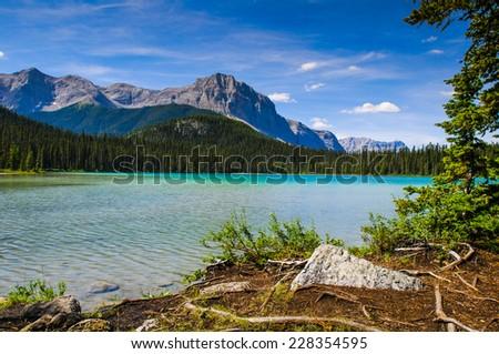 Scenic summer mountain hiking landscapes of Karst Springs and Watridge Lake, Spray Lakes Provincial Park Kananaskis Country Alberta Canada - stock photo