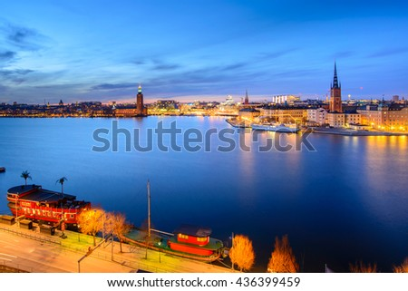 Scenic summer night panorama of the Old Town (Gamla Stan) architecture pier in Stockholm, Sweden   - stock photo