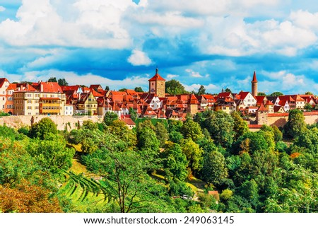 Scenic summer panorama of the Old Town architecture of Rothenburg ob der Tauber, Bavaria, Germany - stock photo