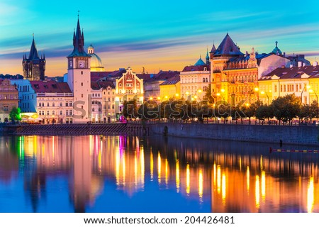 Scenic summer sunset panorama of the Old Town ancient architecture and Vltava river pier in Prague, Czech Republic - stock photo