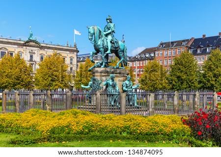 Scenic summer view of Christian V statue in Kongens Nytorv (King's New Square) in Copenhagen, Denmark - stock photo