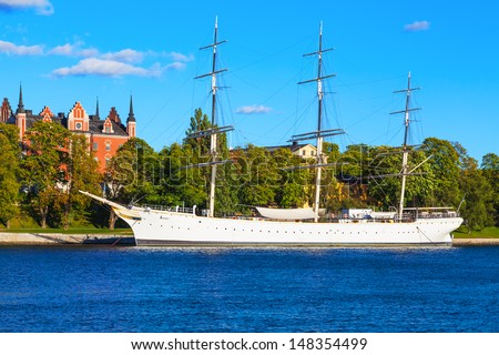 Scenic summer view of historical ship ''AF Chapman'' (built in 1888) at the Skeppsholmen island in the Old Town (Gamla Stan) in Stockholm, Sweden - stock photo