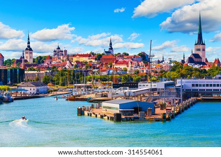 Scenic summer view of the Old Town architecture and sea port harbor in Tallinn, Estonia - stock photo