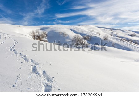 Scenic sunny snowy mountain landscape ideal environment to go trekking with snowshoes - stock photo