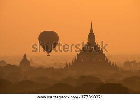 Scenic sunrise at bagan myanmar with balloon fly between ancient pagoda