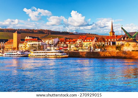Scenic sunset evening view of old buildings at Main river pier and street architecture in the Old Town of Wurzburg, Bavaria, Germany - stock photo
