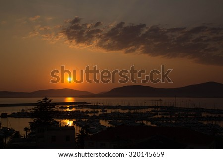 Scenic sunset over the sea in Sardinia - stock photo