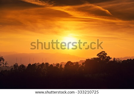 Scenic sunset sun over orange sky background. Los Angeles, California. - stock photo