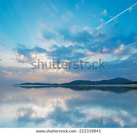 scenic sunset with reflection  in Alghero coastline - stock photo