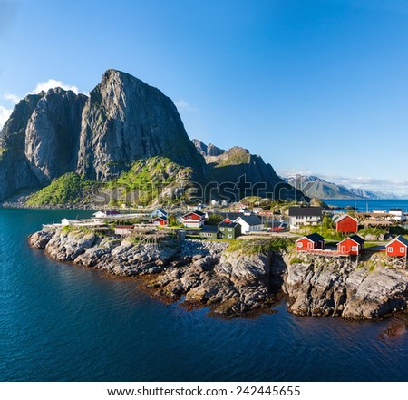Scenic town of Reine by the fjord on Lofoten islands in Norway on sunny summer day - stock photo