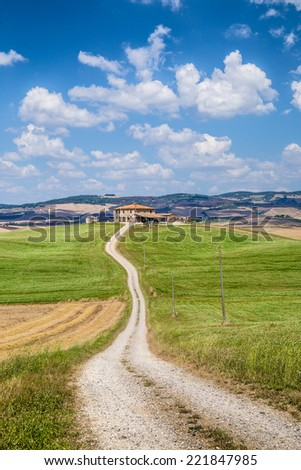 Scenic Tuscany landscape with traditional farm house and rolling hills in Val d'Orcia, Italy - stock photo