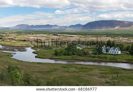 Scenic valley and a village in Thingvellir National park - famous area in Iceland, Iceland - stock photo