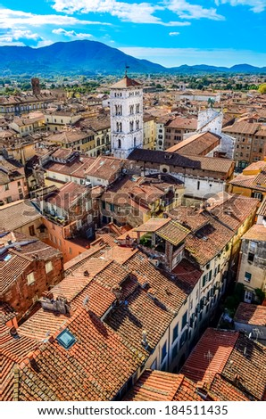 Scenic vertical view of Lucca colorful village from Torre delle Ore, Lucca, Italy - stock photo