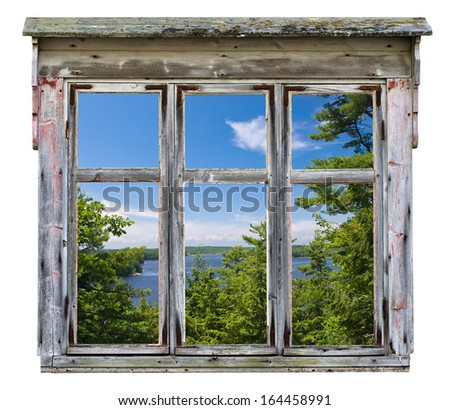 Scenic view across a river with trees, seen through an old rustic window frame - stock photo