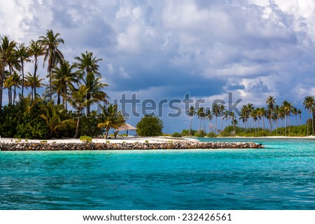 Scenic view at ocean with island near Maldives - stock photo