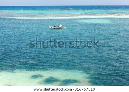 Scenic view at Pacific ocean at Philippines with fisherman in boat, Asia