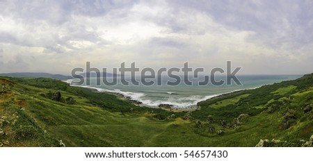 Scenic view downhill towards the ocean at Longpan Park, Taiwan - stock photo