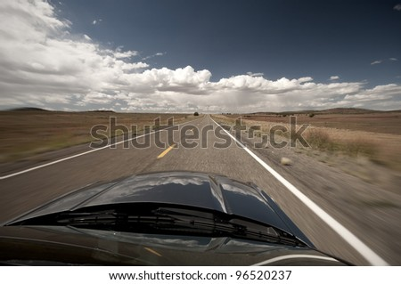 scenic view from car on long lonely old asphalt road Route 66 and blue sky, Ausblick vom Auto auf die lange einsame alte Route 66 mit blauen Himmel - stock photo