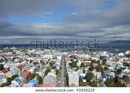 Scenic view from Halgrimskirkja church down on the city of Reykjavik, capital of Iceland - stock photo