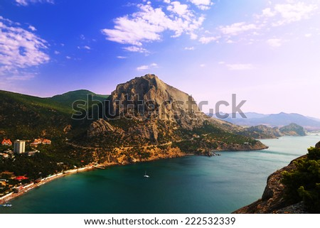 Scenic view from the top of the mountain at Green Bay, the village of Novy Svet and the surrounding mountains at dawn, in the Crimea - stock photo