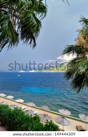 scenic view of a beach, sea and mountains under stormy sky near Marmaris - stock photo