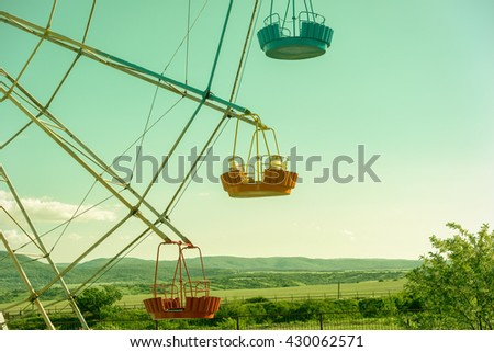 Scenic view of a colourful ferris wheel - stock photo