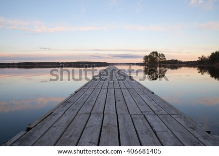 Scenic view of a lake landscape in sunset - stock photo