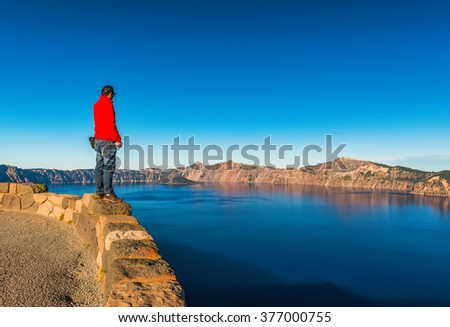 scenic view of a man stand over look to Crater lake National park,Oregon,usa. - stock photo