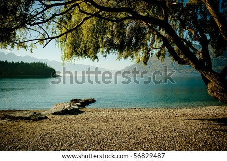 Scenic view of a mountain lake with a clear blue water. - stock photo