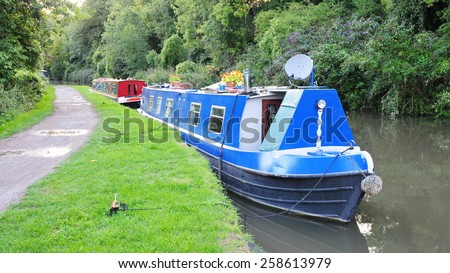 Scenic View of a Narrow Boat on the kennet and Avon Canal near Bath in Somerset England - stock photo