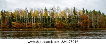 Scenic view of a river in autumn after the sunset - stock photo