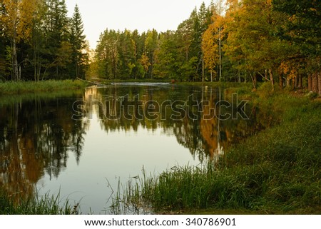 Scenic view of a river landscape before the sunrise in autumn - stock photo