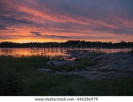 Scenic view of a rocky coast in Sweden at sunset - stock photo