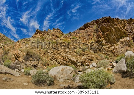 Scenic view of a rugged, rocky mountainside framed against a blue sky. Mo - stock photo