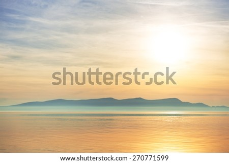 Scenic view of a small island in the sea - stock photo