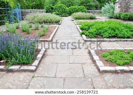 Scenic View of a Stone Paved Garden Path - stock photo