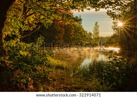 Scenic view of a sunrise river in autumn - stock photo