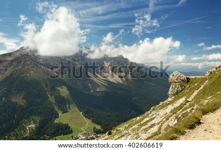 scenic view of a valley in the Dolomites - stock photo