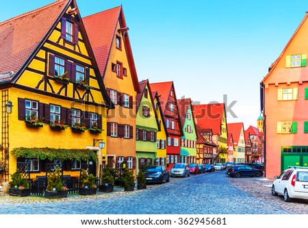 Scenic view of ancient medieval urban street architecture with half-timbered houses in the Old Town of Dinkelsbuhl, Bavaria, Germany