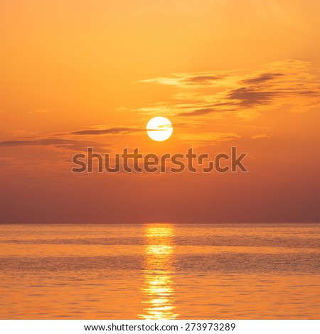 Scenic view of beautiful bright sunset above the sea surface - stock photo
