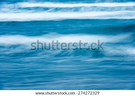 Scenic view of bright blue rough ocean with big foamy waves. Picturesque sea. Beautiful stormy waterscape and natural power. Amazing backgrounds and wallpapers. - stock photo